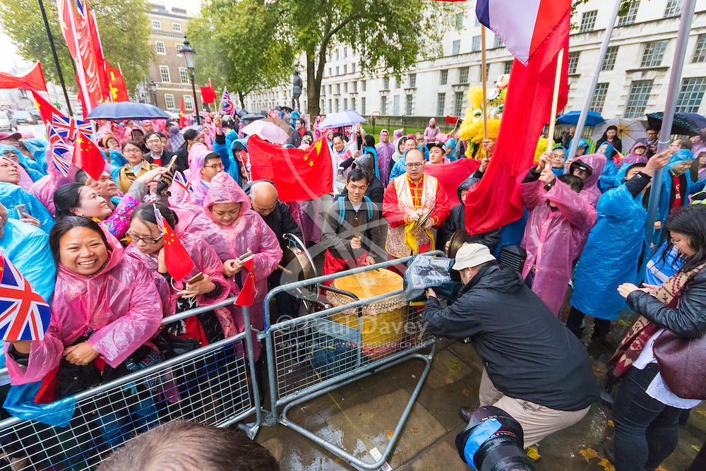 """Whitehall, London, October 21st 2015. Hundreds of Chinese supporters waving banners and wearing """"I Love China"""" T-shirts apparently supplied by the Chinese embassy, face Human rights, Tibetan and Falun Gong protesters as they await the arrival at Downing Street of President Xi Jinpeng."""