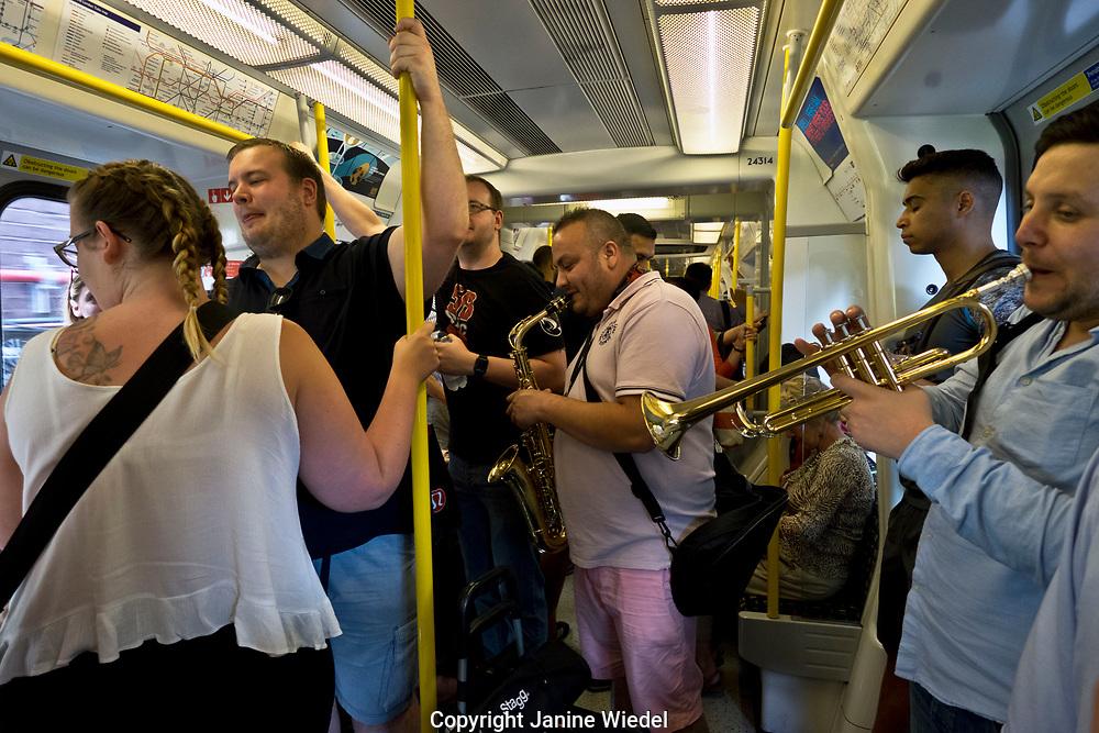 Musicians busking on the underground