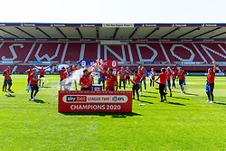 (Free to use courtesy of Sky Bet) Dion Conroy and Mathieu Baudry lift the trophy as Swindon Town gather at The County Ground to celebrate becoming Sky Bet League Two Champions, with a socially distanced trophy lift, after the curtailment of the regular season due to the Covid-19 pandemic - Rogan/JMP - 26/06/2020 - The County Ground - Swindon, England - Sky Bet League 2.