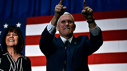 Mike Pence, Vice-presidential candidate for the Republican Party, accompanied by his wife Karen Pence greet voters as the take the stage at a rally in the Philadelphia suburbs, on Friday. (Bastiaan Slabbers for NewsWorks)