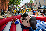 Xavier Griffin, 8, of Franklin rides the mechanical bull at the 34th Main Street Festival in Franklin. (The Tennessean)