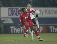 FLORENT SINAMA PONGOLLE HOLDS OF KEVIN NICHOLLS-.PIC BY KIERAN GALVIN / COLORSPORT