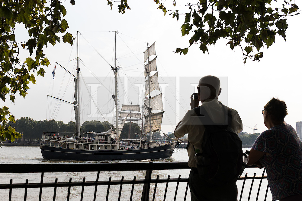 © Licensed to London News Pictures. 15/06/2016. LONDON, UK.  People watch historic tall ships passing from the Thames path on the River Thames. The Sail Royal Greenwich Tall Ship Festival runs until this Sunday, 18th Septmeber.  Photo credit: Vickie Flores/LNP
