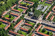 Nederland, Noord-Holland, Amsterdam, 14-06-2012; Woonbuurt in Slotervaart, eengezinswoningen gebouwd volgens ruim opgezet stratenplan. Burgemeester Rendorpstraat, diagonaal met doopsgezinde kerk De Olijftak,  nu in gebruik als Moskee El Hijra (Marokkaans). De moordenaar Mohammed Bouyeri van Theo van Gogh woonde in deze buurt...De wijk is onderdeel van de Westelijke Tuinsteden, gerealiseerd op basis van het Algemeen Uitbreidingsplan voor Amsterdam (AUP, 1935). Voorbeeld van het Nieuwe Bouwen, open bebouwing in stroken, langwerpige bouwblokken afgewisseld met groenstroken. .Residential district Slotervaart, one of the western garden cities of Amsterdam-west..  Constructed on the basis of the General Extension Plan for Amsterdam (AUP, 1935). Example of the New Building (het Nieuwe Bouwen), detached in strips, oblong housing blocks alternated with green areas, built in fifties and sixties of the 20th century. Church is now a mosque..luchtfoto (toeslag), aerial photo (additional fee required).foto/photo Siebe Swart