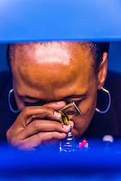 Woman polishing diamonds, Cullinan Diamond Mine, Cullinan, 30 km (19 mi) east of Pretoria The town is named after diamond magnate Sir Thomas Cullinan.