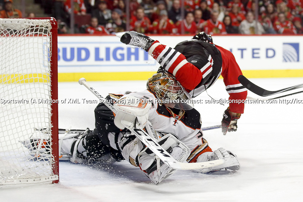 13 February 2016: Anaheim Ducks Goalie John Gibson (36) [8939] collides with Chicago Blackhawks Right Wing Richard Panik (14) [7145] to block a shot in action during a game between the Anaheim Ducks and the Chicago Blackhawks at the United Center, in Chicago, IL.    (Photo by Robin Alam/Icon Sportswire)
