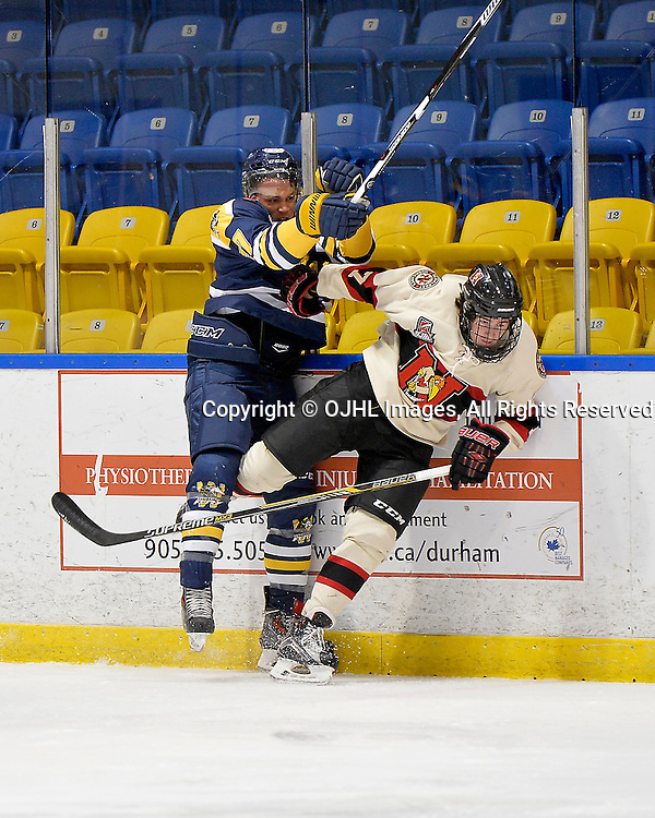 WHITBY, ON - Oct 9, 2015 : Ontario Junior Hockey League game action between Newmarket and Whitby, Austin Ulett #27 of the Whitby Fury makes the hit on Max Routledge #7 of the Newmarket Hurricanes during the second period.<br /> (Photo by Shawn Muir / OJHL Images)