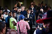 Prima manifestazione dei migranti all'anagrafe centrale di Torino per richiedere la residenza presso le palazzine del villaggio olimpico. Il corteo è giunto fino all'interno degli uffici comunali senza bloccarne le procedure ed attendendo un incontro con le istituzioni. Nell'immagine il momento di dialogo fra l'assessore Gallo e i migranti. Torino, 19-04-'13.
