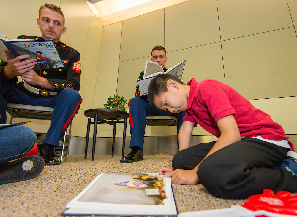 "Students read ""The Wall"" with marines during the reveal of the 32 finalists in the Houston ISD NCAA Read to the Final Four, November 11, 2015."