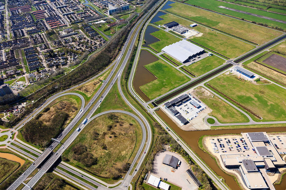 Nederland, Friesland, Gemeente Smallingerland, 01-05-2013; Bedrijvenpark Drachten Azeven, gelegen in de oksel van knooppunt Drachten (A7/N31). De structuur van de polders van Drachtstercompagnie (Fries: Drachtster Kompenije) wordt aangetast.<br /> The structure of the polders is affected by the development of  business park Drachten Azeven. Motorway seperates the polder from the city.<br /> luchtfoto (toeslag op standard tarieven)<br /> aerial photo (additional fee required)<br /> copyright foto/photo Siebe Swart
