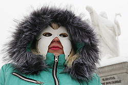 December 17, 2018 - Kiev, Ukraine - An Ukrainian woman wearing a white mask takes a part at a protest of activists and former sex workers against violence and cruelty towards sex workers in downtown Kiev, Ukraine, on 17 December 2018. The protets protest timed to the International Day to End Violence Against Sex Workers, which is mark annually on 17 December in the world. (Credit Image: © Serg Glovny/ZUMA Wire)