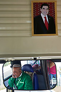 Ashgabat, Turkmenistan - 2017 September 20: Bus driver in the mirror and picture of  Gurbanguly Berdimuhamedow President of Turkmenistan while 2017 Ashgabat 5th Asian Indoor &amp; Martial Arts Games on September 20, 2017 in Ashgabat, Turkmenistan.<br /> <br /> Mandatory credit:<br /> Photo by &copy; Adam Nurkiewicz<br /> <br /> Adam Nurkiewicz declares that he has no rights to the image of people at the photographs of his authorship.<br /> <br /> Picture also available in RAW (NEF) or TIFF format on special request.<br /> <br /> Any editorial, commercial or promotional use requires written permission from the author of image.