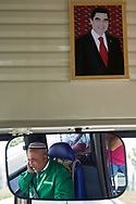 Ashgabat, Turkmenistan - 2017 September 20: Bus driver in the mirror and picture of  Gurbanguly Berdimuhamedow President of Turkmenistan while 2017 Ashgabat 5th Asian Indoor & Martial Arts Games on September 20, 2017 in Ashgabat, Turkmenistan.<br /> <br /> Mandatory credit:<br /> Photo by © Adam Nurkiewicz<br /> <br /> Adam Nurkiewicz declares that he has no rights to the image of people at the photographs of his authorship.<br /> <br /> Picture also available in RAW (NEF) or TIFF format on special request.<br /> <br /> Any editorial, commercial or promotional use requires written permission from the author of image.