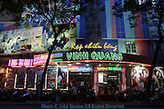 The colorful Vinh Quang cinema is filled with movie goers on a beautiful evening in Saigon (Ho Chi Minh City) Vietnam.
