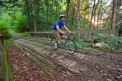 A man mountain biking on the Catamount Trail in Wolcott, Vermont.
