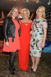 Left to right, sisters PAULA COYLE, NATALIE COYLE and DANIELLE COYLE at a party to celebrate the engagement of Natalie Coyle and Zafar Rushdie held at Library, St.Martin's Lane, London on 6th September 2014.
