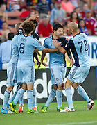 FRISCO, TX - JUNE 22:  Kei Kamara #23 of Sporting Kansas City celebrates with teammates after scoring on a penalty kick against FC Dallas on June 22, 2013 at FC Dallas Stadium in Frisco, Texas.  (Photo by Cooper Neill/Getty Images) *** Local Caption *** Kei Kamara