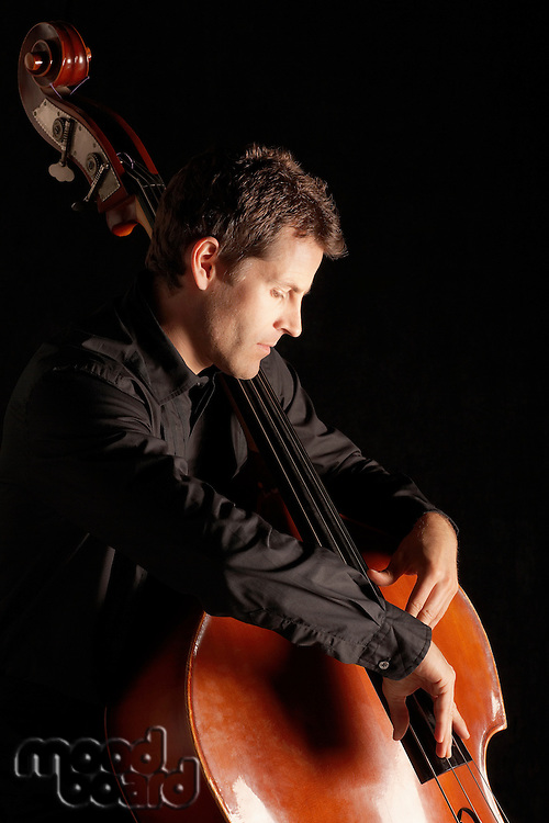 Man Playing Double Bass side view