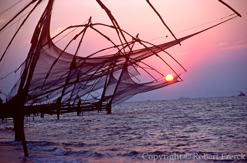 INDIA, SOUTH Kerala State:Cochin; Indian fishermen using Chinese nets along Malabar Coast