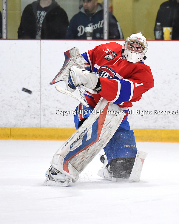 BURLINGTON, - Mar 2, 2016 -  Ontario Junior Hockey League game action between Burlington Cougars and the Toronto Junior Canadians. Game 1 of the first round playoff series at the Appleby Ice Centre, ON. Brendan Bonello #1 of the Toronto Jr. Canadiens clears the puck during the first period.<br /> (Photo by Andy Corneau / OJHL Images)