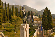 Piazzetta del Pilo del Piave, with a stone column built 1934-35 symbolising the broken arch of a bridge near the Piave, and on top, a Vittoria del Piave, 1935, by Arrigo Minerbi, with chained feet, symbolising the will of resistance of the Italian army after the Caporetto route, at Vittoriale degli italiani, or The Shrine of Italian Victories, the home, estate and museums of Gabriele D'Annunzio, 1863-1938, Italian writer, soldier and fascist, at Gardone Riviera, Lake Garda, Brescia, Lombardy, Italy. The estate consists of the Prioria, where d'Annunzio lived 1922-38, an amphitheatre, the protected cruiser Puglia, the MAS vessel used by D'Annunzio in 1918 and a mausoleum. It is part of the Grandi Giardini Italiani. Picture by Manuel Cohen