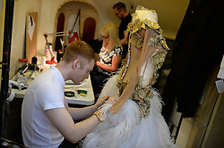 © London News Pictures. Alterations are made to dresses at the British Ballroom dance championships at the Winter Gardens in Blackpool 27-05-2015. The first Blackpool Dance Festival was held  in 1920 now has 60 countries represented with total number of 2,950 couples competing. Photo credit: Nigel Roddis/LNP