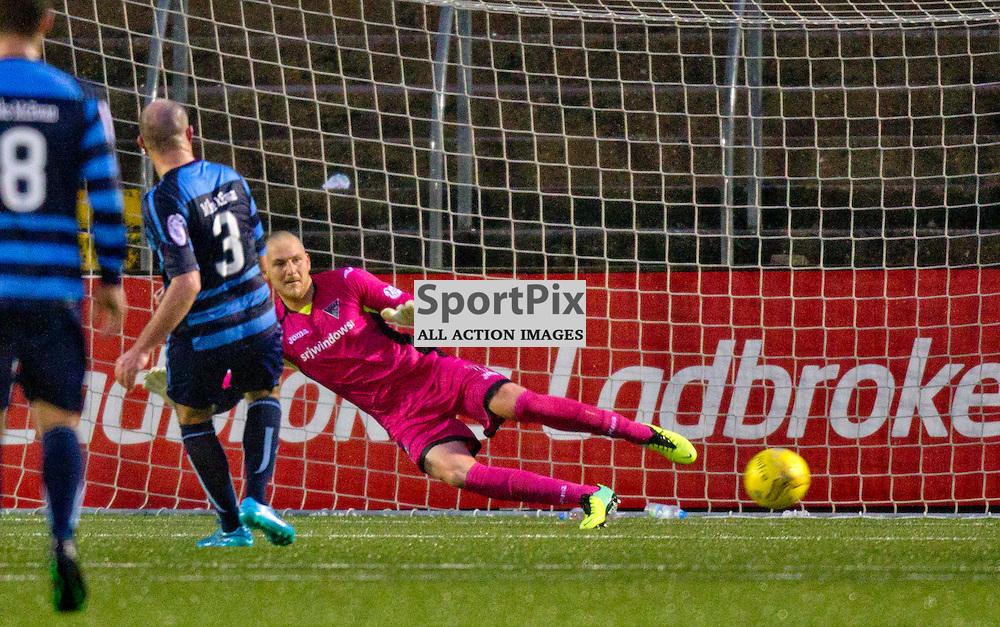 Forfar Athletic v Dunfermline Athletic SPFL League One Season 2015/16 Station Park 26 December 2015<br /> Ian Campbell beats Sean Murodch from the spot<br /> CRAIG BROWN | sportPix.org.uk