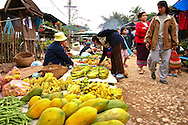 Papayas at the Morning Market, Luang Prabang - a large array of outdoor stalls selling pretty much everything from papayas to baskets; opening up at sunrise and remaining open until around 12:00 noon.