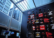 Employee Alphonso Jamerson (cq) sets up a display of Chicago sports merchandise inside the new New Era store at 207 S State St. in the Loop on Wednesday, Nov. 9, 2011.<br /> <br /> (Brian Cassella/ Chicago Tribune) B581678814Z.1<br /> ....OUTSIDE TRIBUNE CO.- NO MAGS,  NO SALES, NO INTERNET, NO TV, NEW YORK TIMES OUT, CHICAGO OUT, NO DIGITAL MANIPULATION...