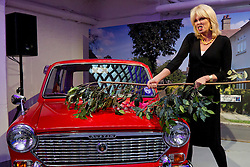 © Licensed to London News Pictures. 27/09/2012. LONDON, UK. Actress Joanna Lumley hits the original car thrashed by John Cleese in the sitcom 'Fawlty Towers' at the launch of YouView in London today (27/09/12). YouView, launched today by broad band provider TalkTalk, provides on demand television for its customers who will be given the set-top boxes for free. Photo credit: Matt Cetti-Roberts/LNP