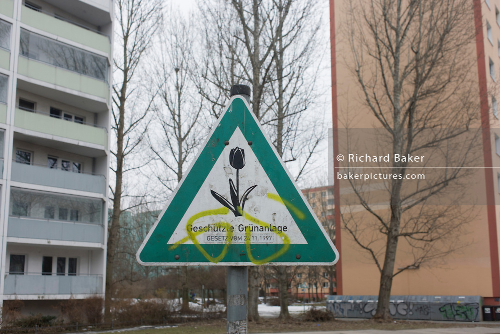 A sign for the green environment in a housing estate located in the former Eastern Bloc Communist East Germany known as the GDR (German Democratic Republic) during the cold war. This was once a restricted zone due to its proximity to the notorious secret police (Stasi) Hohenschonhausen prison before the fall of the Berlin wall in Nov 1989.