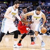 22 November 2016: Denver Nuggets forward Danilo Gallinari (8) drives past Chicago Bulls forward Jimmy Butler (21) on a screen set by Denver Nuggets center Jusuf Nurkic (23) during the Denver Nuggets 110-107 victory over the Chicago Bulls, at the Pepsi Center, Denver, Colorado, USA.