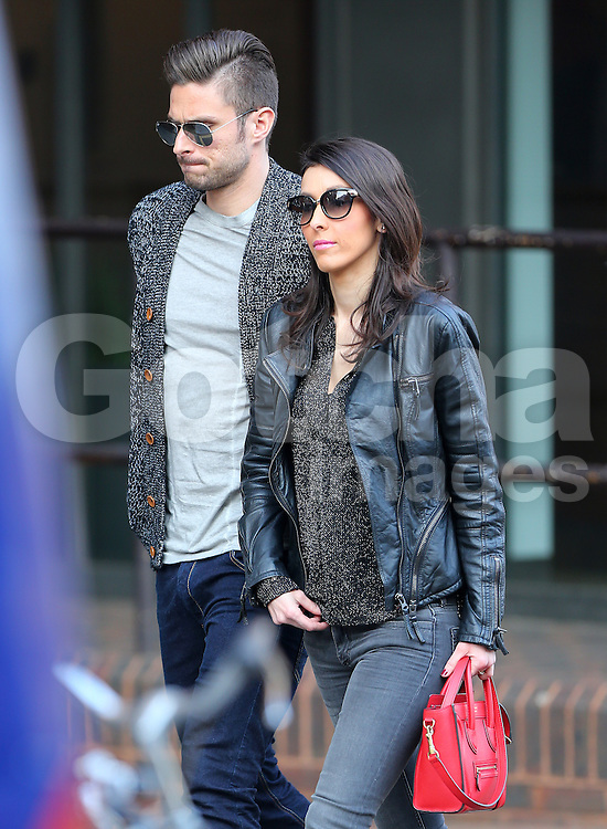 Arsenal striker Olivier Giroud and his stunning wife Jennifer out shopping together in north London. The pair walked hand in hand, looking very much in love dispite Olivier's alleged hotel tryst with glamour FHM model Celia Kay in February. After browsing the shops and picking up supplies from a local Tesco's, the pairs public display of affection continued as they stopped for a loving kiss, before heading back to their car. UK. 12/03/2014 <br />BYLINE MUST READ : JAMESY/GOTCHA IMAGES<br /><br />Copyright by &copy; Gotcha Images Ltd. All rights reserved.<br />Usage of this image is conditional upon the acceptance <br />of Gotcha Images Ltd, terms and conditions available at<br />www.gotchaimages.com