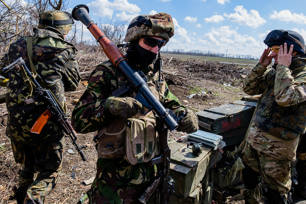 Soldiers getting ready to counter attack the separatists who were firing mortars at us this morning.
