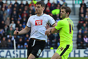 Derby County forward Chris Martin and Huddersfield Town defender Martin Cranie tussle for the ball during the Sky Bet Championship match between Derby County and Huddersfield Town at the iPro Stadium, Derby, England on 5 March 2016. Photo by Aaron Lupton.