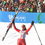 Picabo Street of the USA celebrates on the podium after winning a gold medal in the Womens Super G at the Nagano Winter Olympics in February 1998. Photo by August Miller