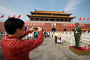 Tian'anmen Square (Place of Heavenly Peace). Tian'anmen Gate. Mao portrait. Chinese taking souvenir photos.