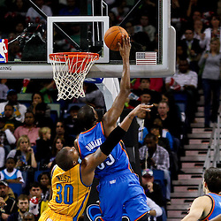 December 10, 2010; New Orleans, LA, USA; Oklahoma City Thunder forward Kevin Durant (35) shoots over New Orleans Hornets power forward David West (30) during the second half at the New Orleans Arena.  The Thunder defeated the Hornets 97-92. Mandatory Credit: Derick E. Hingle-US PRESSWIRE