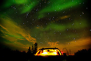 Northern lights or aurora borealis and vehicle<br /> Dugald<br /> Manitoba<br /> Canada
