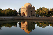 Mausoleum of the Samanids, 9th-10th century, Bukhara, Uzbekistan, pictured on July 11, 2010 reflected in a pool by the late afternoon light. Built of kiln-dried bricks by Ismail Samani for his father Nasr I, who died in 892, it is recognized as architectural masterpiece of the world heritage due to harmony of its geometrical forms. Bukhara, a city on the Silk Route is about 2500 years old. Its long history is displayed both through the impressive monuments and the overall town planning and architecture. Picture by Manuel Cohen.