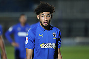 AFC Wimbledon midfielder Tyler Burey (32) walking off the pitch during the EFL Trophy group stage match between AFC Wimbledon and Stevenage at the Cherry Red Records Stadium, Kingston, England on 6 November 2018.
