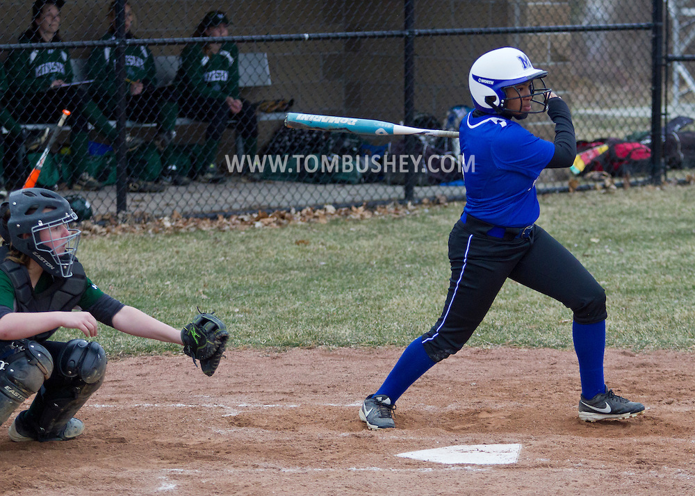 Middletown, New York -  A Middletown batter swings at a pitch during a varsity girls' softball game on April 7, 2014.