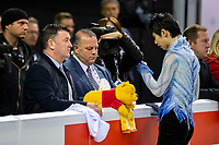 KELOWNA, BC - OCTOBER 25: Japanese figure skater, Yuzuru Hanyu stands at the boards with coach Brian Orser at the start of the men's short program at Skate Canada International held at Prospera Place on October 25, 2019 in Kelowna, Canada. (Photo by Marissa Baecker/Shoot the Breeze)