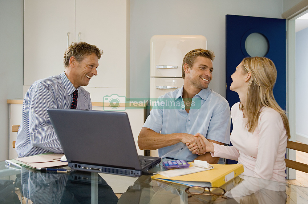 Dec. 14, 2012 - Couple and financial adviser (Credit Image: © Image Source/ZUMAPRESS.com)
