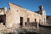 The crumbling walls of the Cortijo del Fraile, farmhouse and chapel built by Dominican monks in the 18th century, now abandoned, in the Cabo de Gata-Nijar Natural Park, Almeria, Andalusia, Southern Spain. This is the scene of the notorious 'Crime of Nijar', when a man was shot dead in the chapel to prevent him eloping with a bride promised to the gunman's brother. The park includes the Sierra del Cabo de Gata mountain range, volcanic rock landscapes, islands, coastline and coral reefs and has the only warm desert climate in Europe. The park was listed as a UNESCO Biosphere Reserve in 1997 and a Specially Protected Area of Mediterranean Importance in 2001. Picture by Manuel Cohen