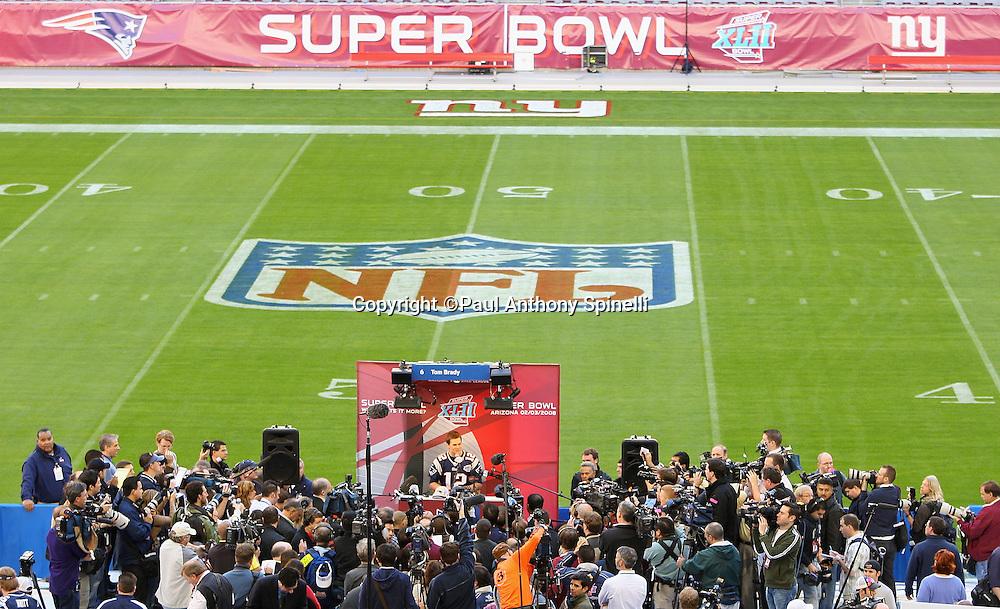 GLENDALE, AZ - JANUARY 29: Quarterback Tom Brady #12 of the New England Patriots speaks to the media at the Patriots Super Bowl XLII Media Day at University of Phoenix Stadium on January 29, 2008 in Glendale, Arizona.©Paul Anthony Spinelli *** Local Caption *** Tom Brady