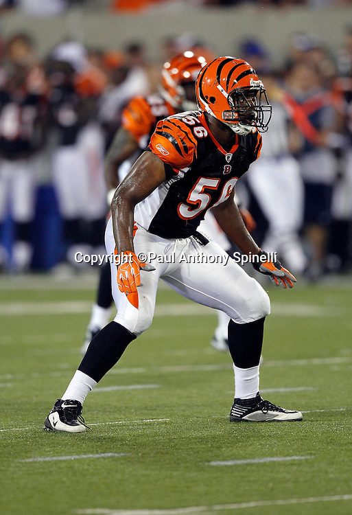 Cincinnati Bengals rookie linebacker Roddrick Muckelroy (56) gets set during the NFL Pro Football Hall of Fame preseason football game between the Dallas Cowboys and the Cincinnati Bengals on Sunday, August 8, 2010 in Canton, Ohio. The Cowboys won the game 16-7. (©Paul Anthony Spinelli)