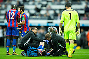Crystal Palace medical team members check on the injured Scott Dann (#6) of Crystal Palace during the Premier League match between Newcastle United and Crystal Palace at St. James's Park, Newcastle, England on 21 October 2017. Photo by Craig Doyle.