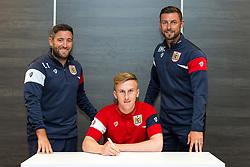 Bristol City Head Coach Lee Johnson and Assistant Head Coach Jamie McAllister look on as Connor Lemonheigh-Evans signs a new contract with Bristol City Under 23s ahead of the 2017/18 Season - Rogan/JMP - 11/07/2017 - Ashton Gate Stadium - Bristol, England.