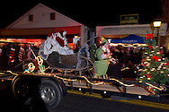 Pine Bush, New York - Santa Claus and Mrs. Claus wave to the crowd on Main Street during the Community Country Christmas presented by the Pine Bush Chamber of Commerce on Dec. 1, 2012.